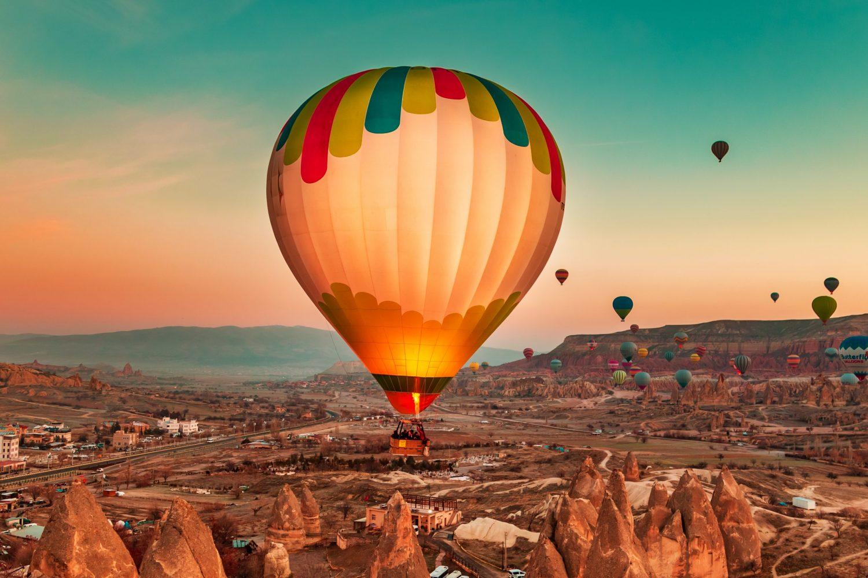 Magnificent dawn with hot air balloons. Cappadocia, Goreme, Turkey - January 29, 2019.